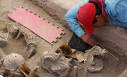 archaeologists-uncovering-skeletons-puebla.jpg